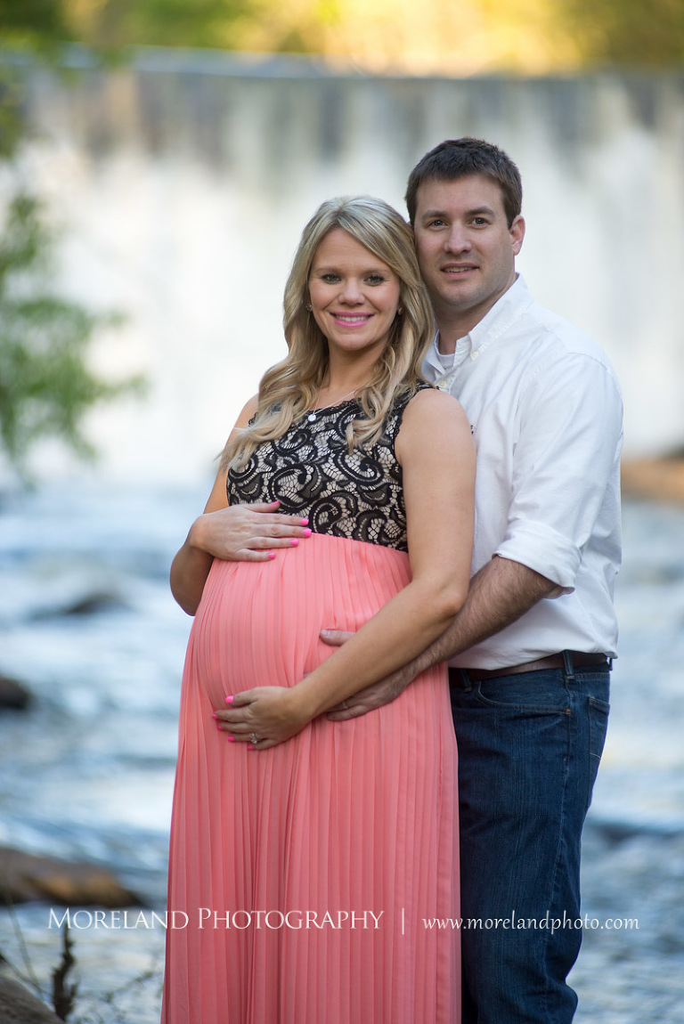 Husband Holding His Wife From Behind With A Waterfall In The Background Atlanta Maternity Photographer