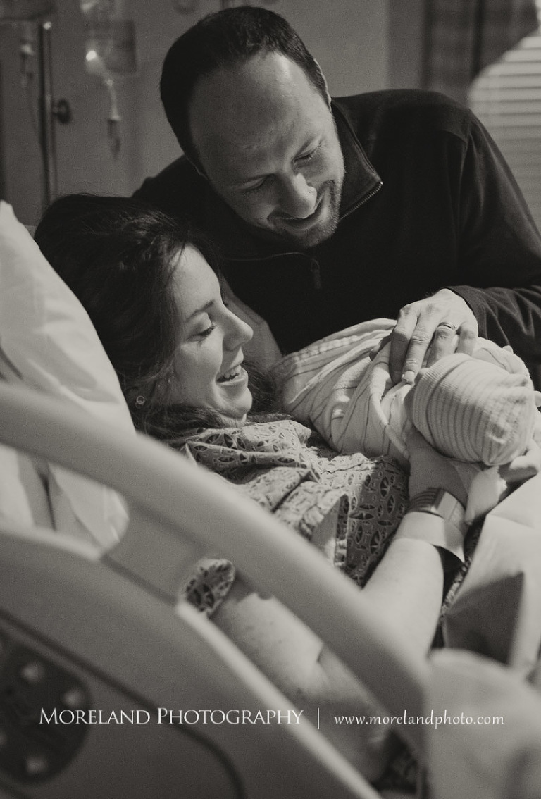 Atlanta birth photography birth newborn photography grey scale image of a happy couple holding